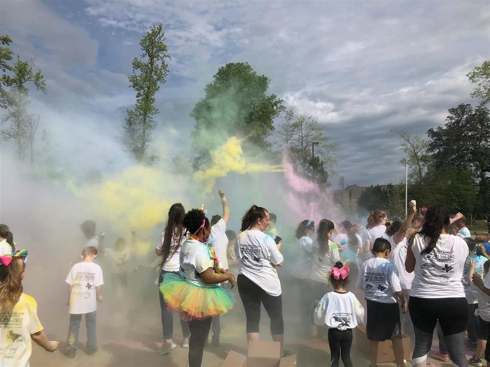Students throwing color powder