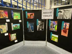 Rodeo art on display in the library.